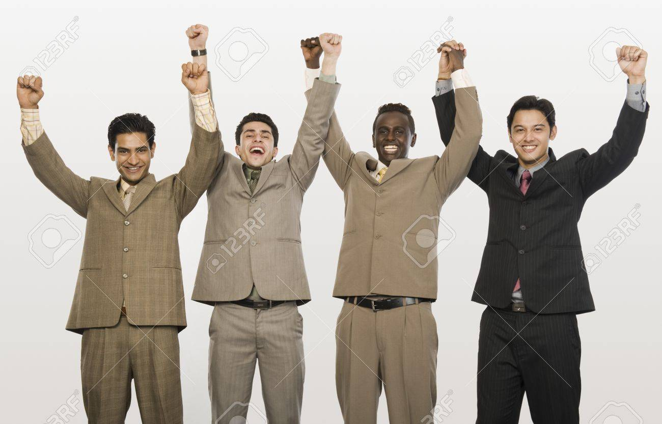 Portrait of four businessmen with arms raised Stock Photo - 10124995