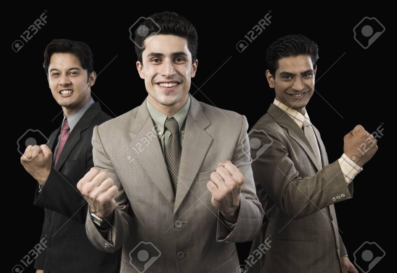 Portrait of three businessmen cheering Stock Photo - 10169410