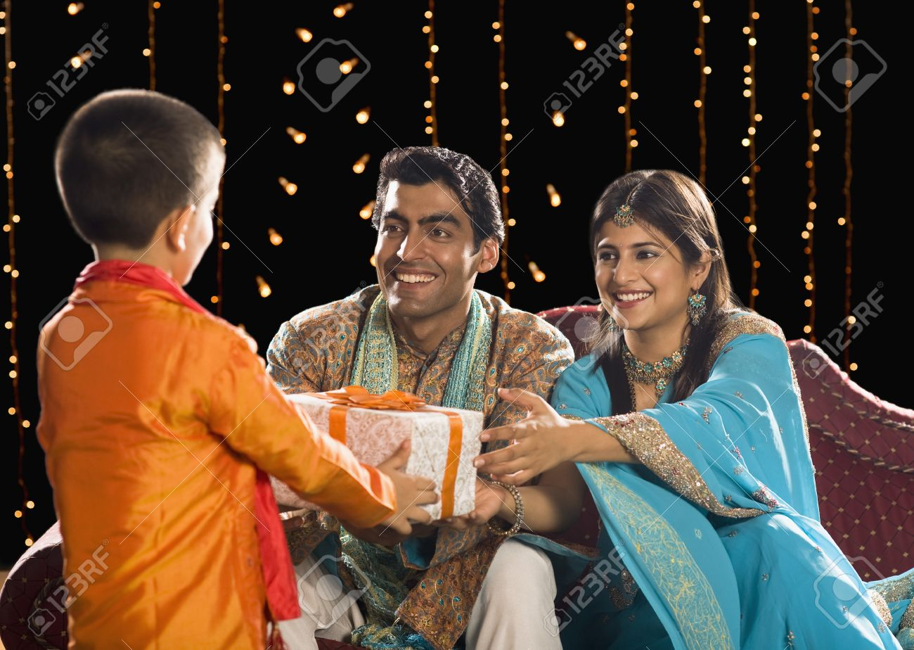 Couple Giving Diwali Gift To Their Son Stock Photo, Picture And ... for Diwali Gifts For Family  143gtk