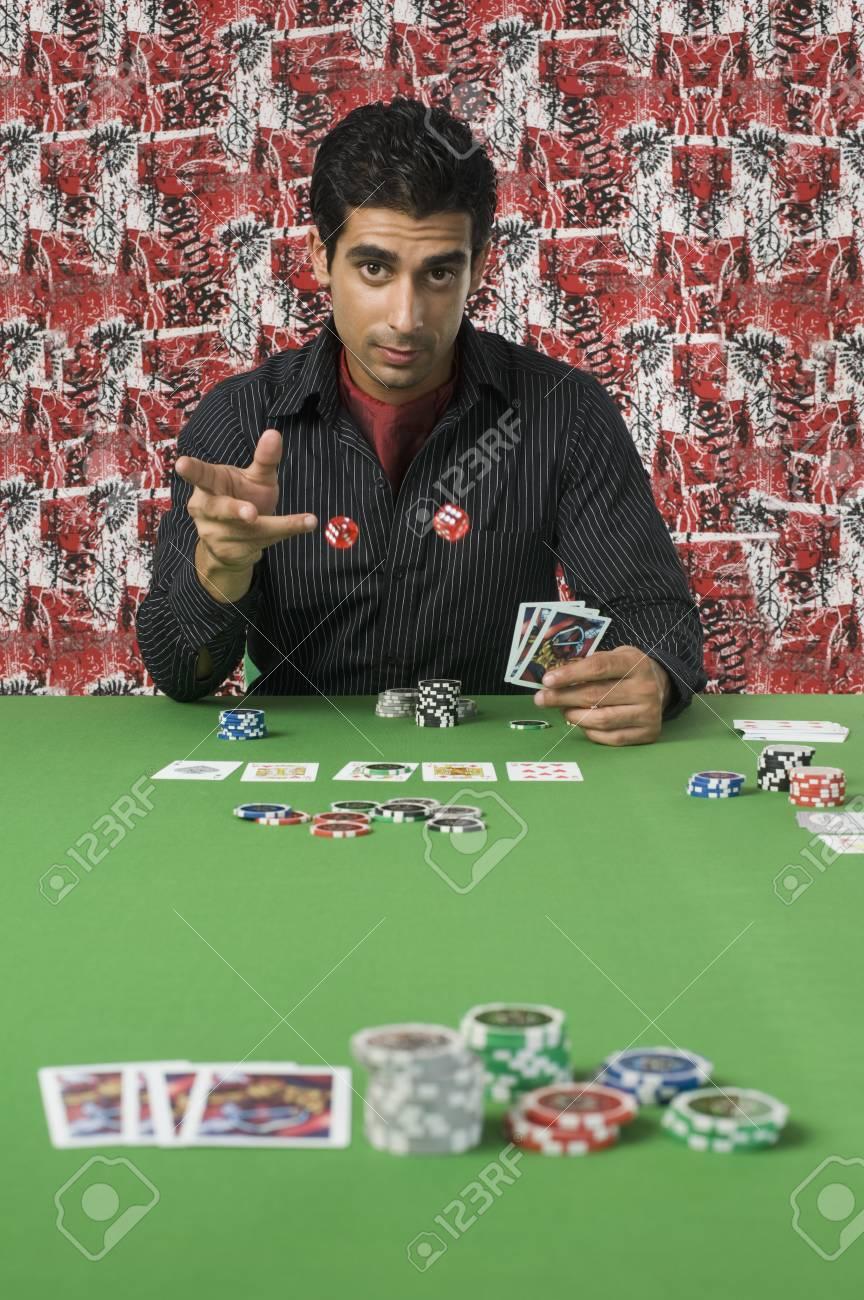 Portrait of a man gambling in a casino Stock Photo - 10166676