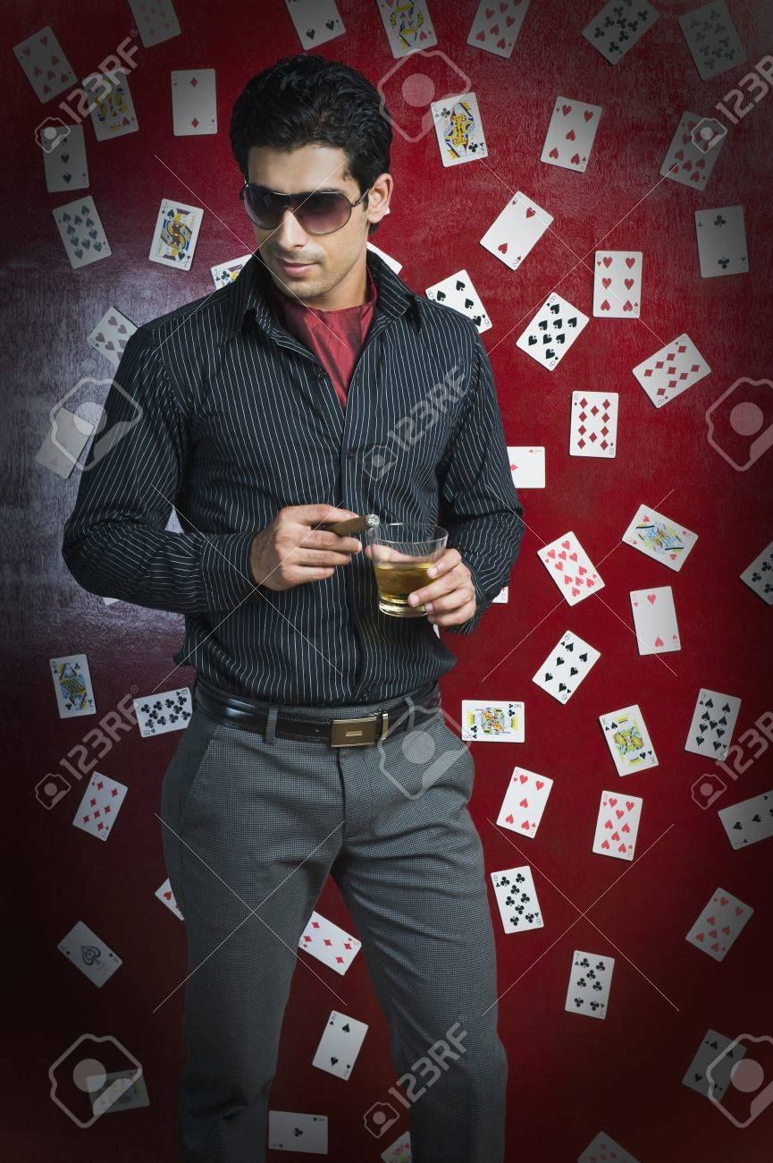 Man drinking and smoking in a casino Stock Photo - 10166685