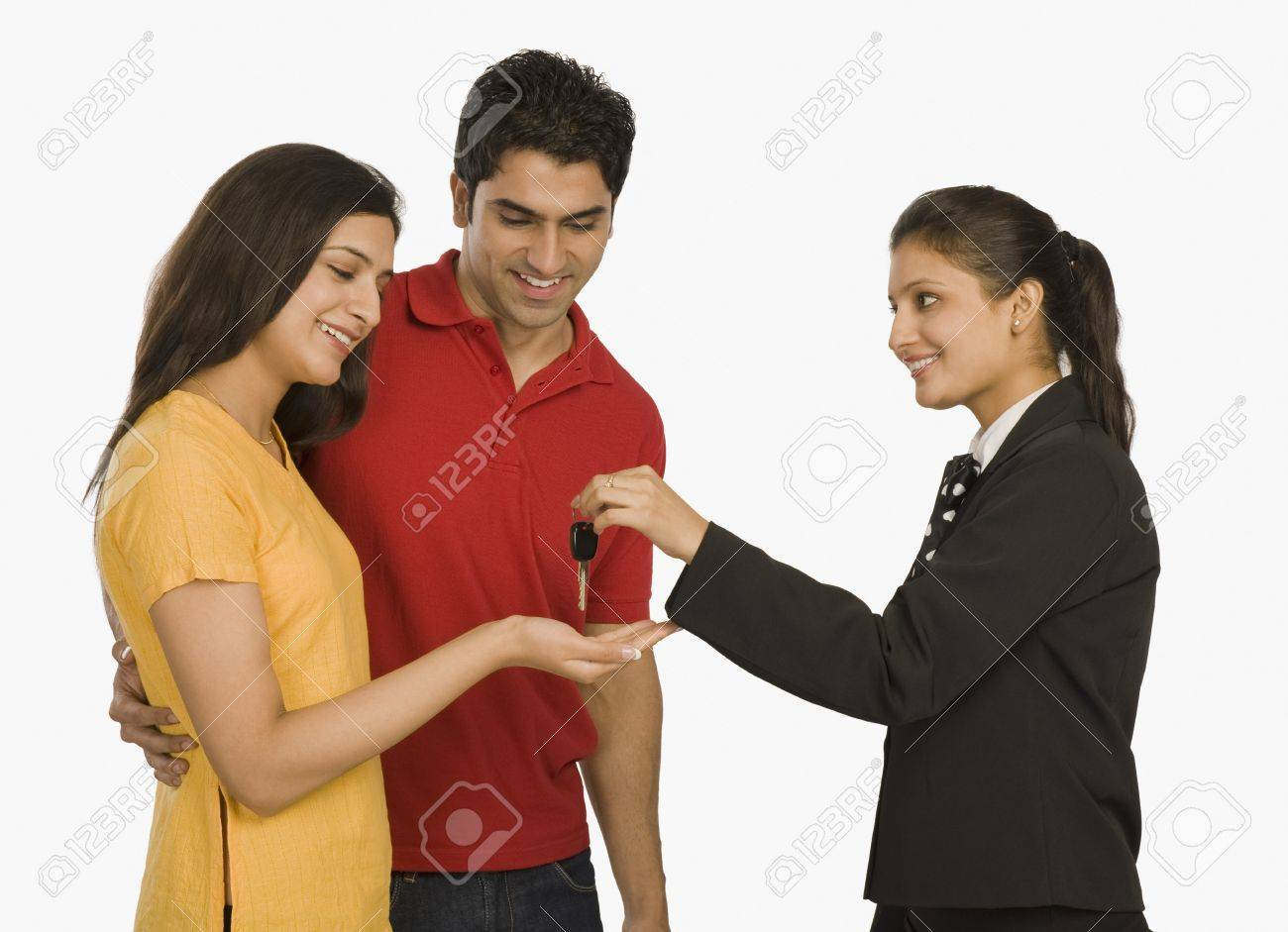 Businesswomen giving a car key to a woman Stock Photo - 10124557