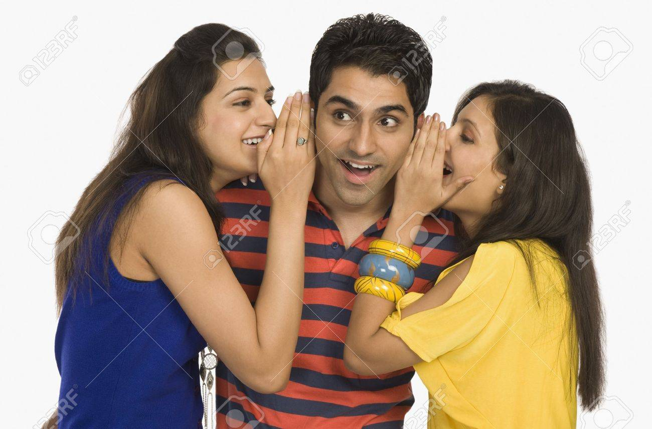 Two women whispering to a man Stock Photo - 10169268