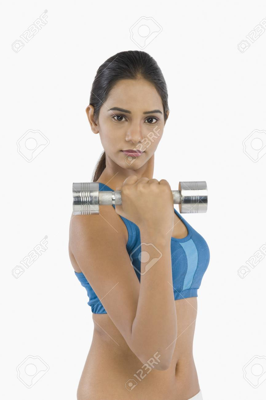Woman exercising with a dumbbell Stock Photo - 10124135