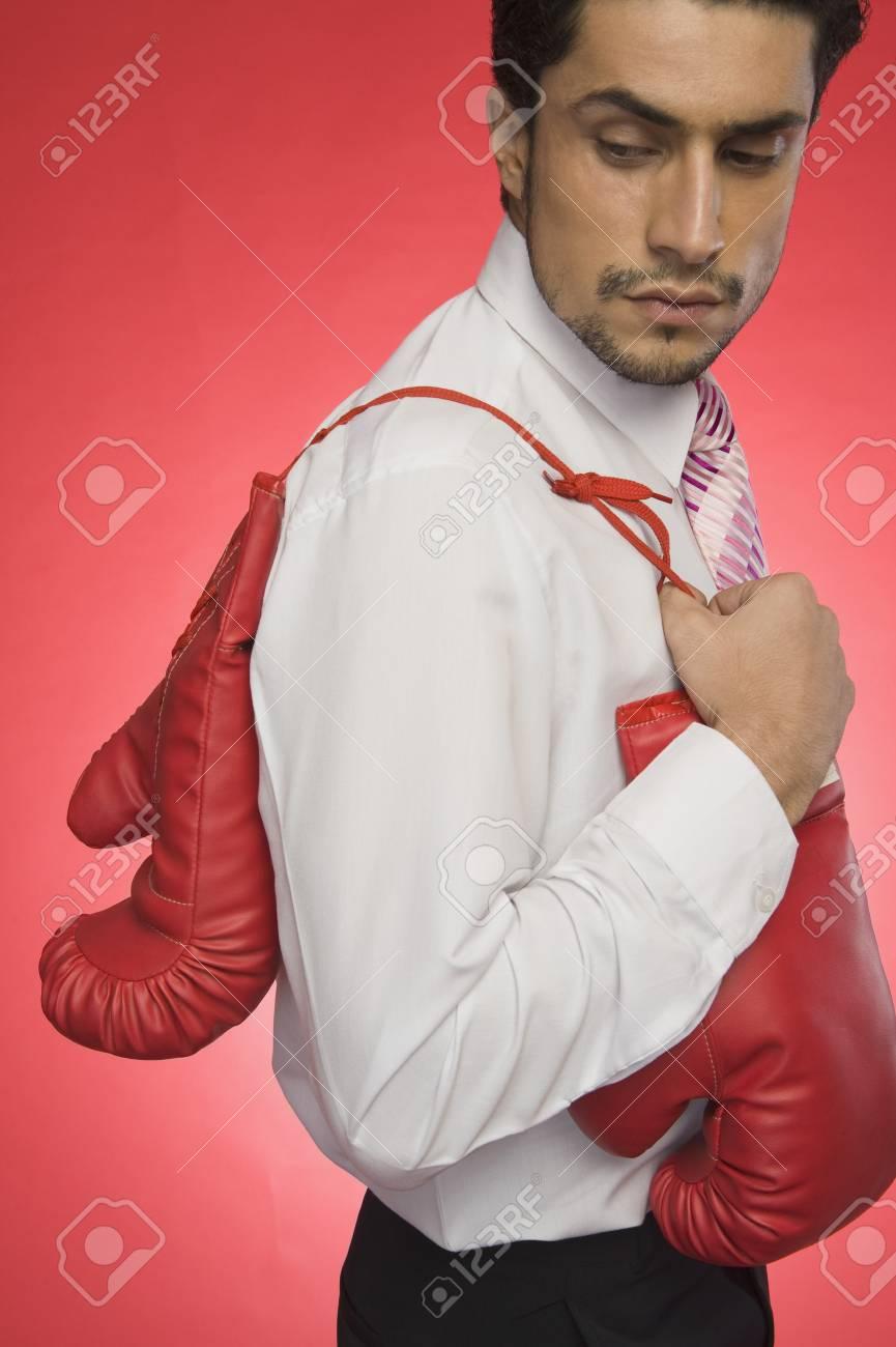 Businessman holding boxing gloves Stock Photo - 10168044