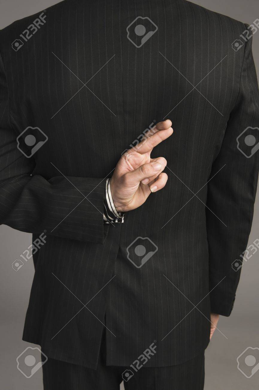 Businessman with fingers crossed behind his back Stock Photo - 10167946