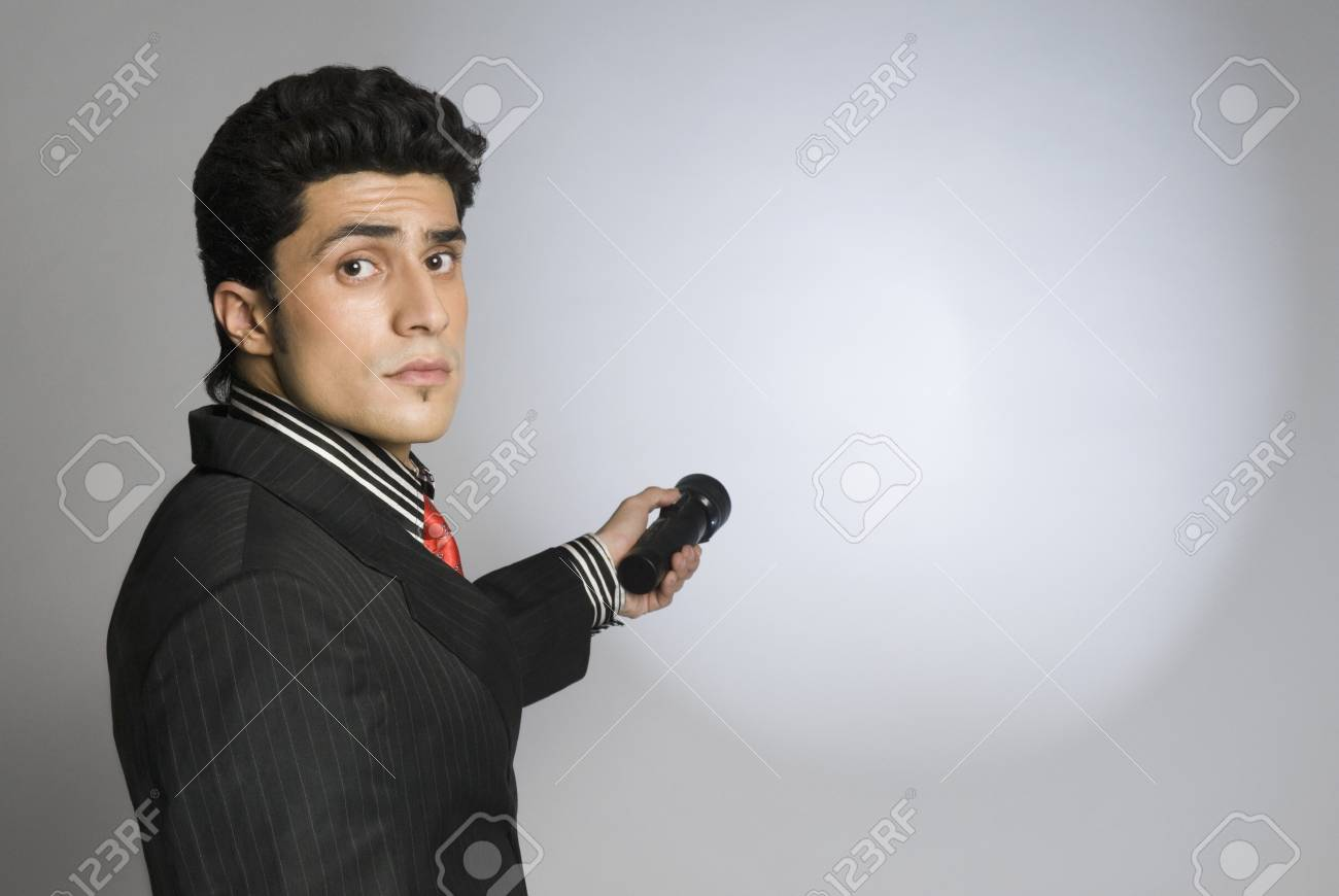 Businessman holding a flashlight Stock Photo - 10167484