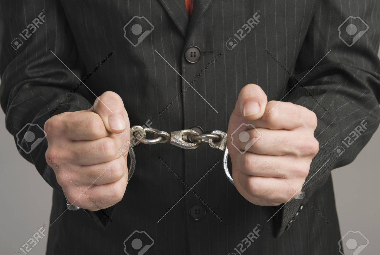 Close-up of a businessman tied up with handcuffs Stock Photo - 10168370