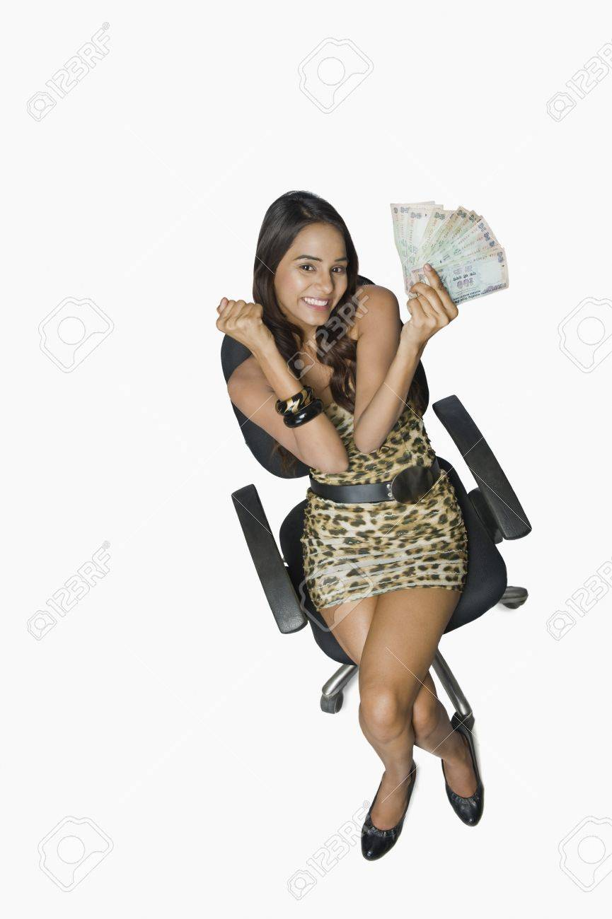 Woman holding currency notes and looking excited Stock Photo - 10168919