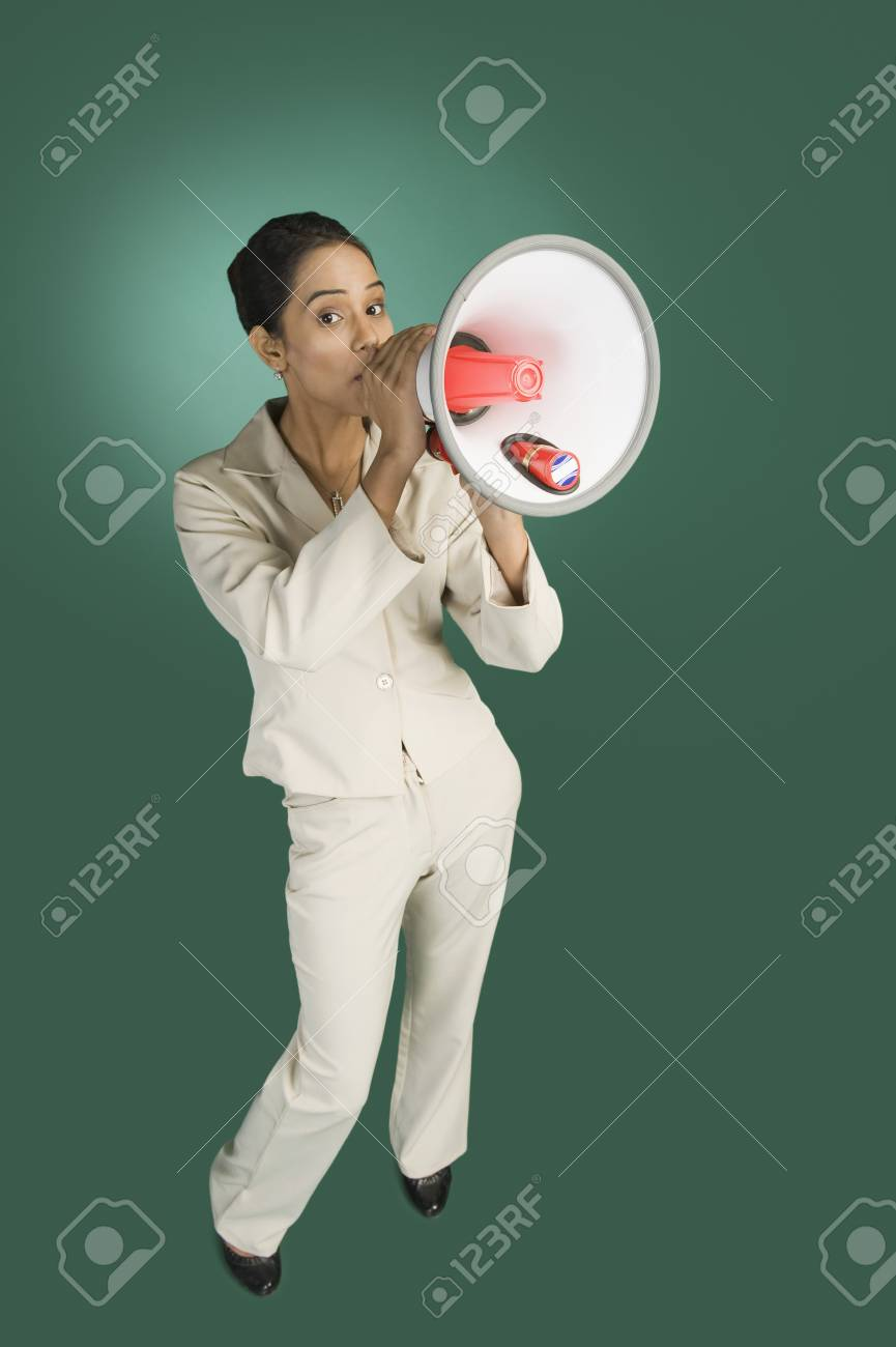 Businesswoman announcing with a megaphone Stock Photo - 10168691