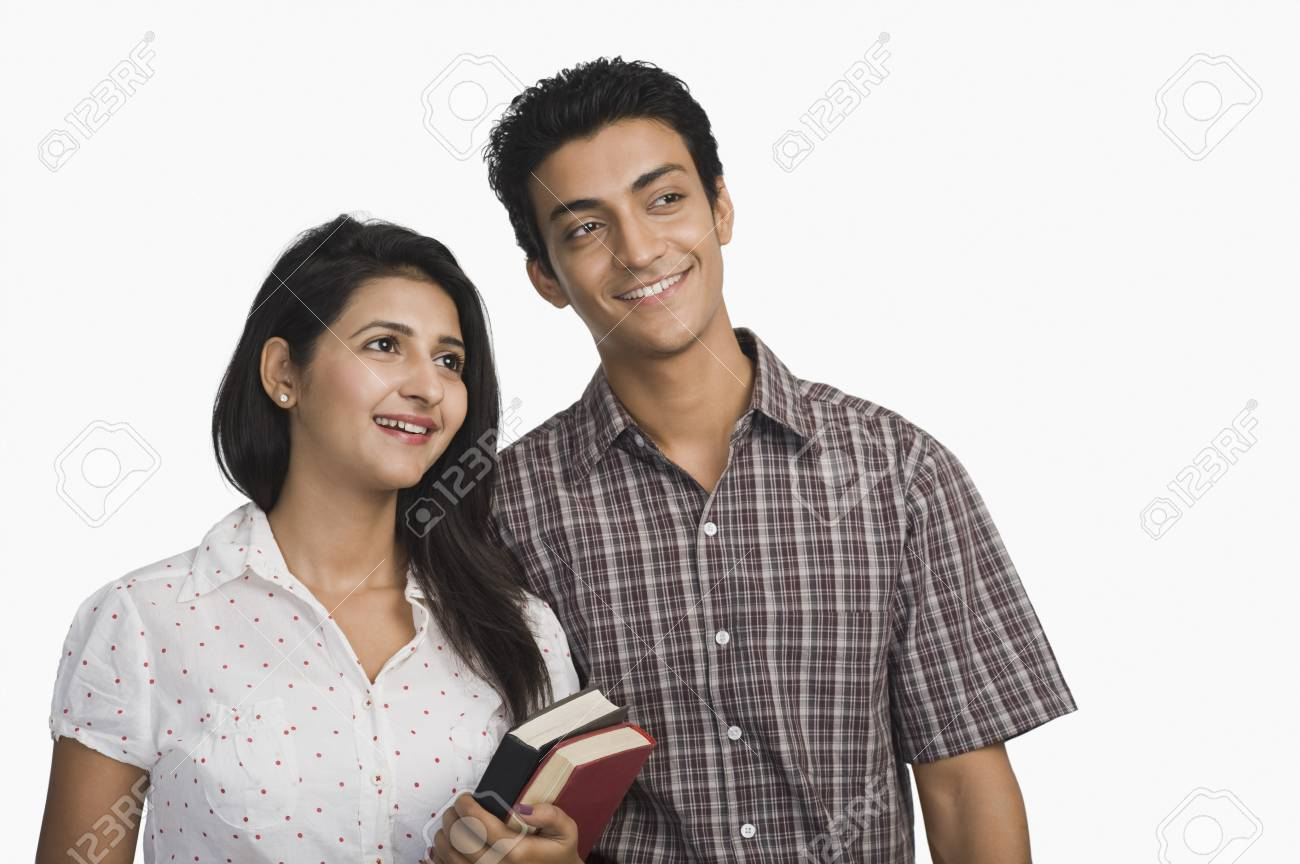 College students holding books and smiling Stock Photo - 10167224