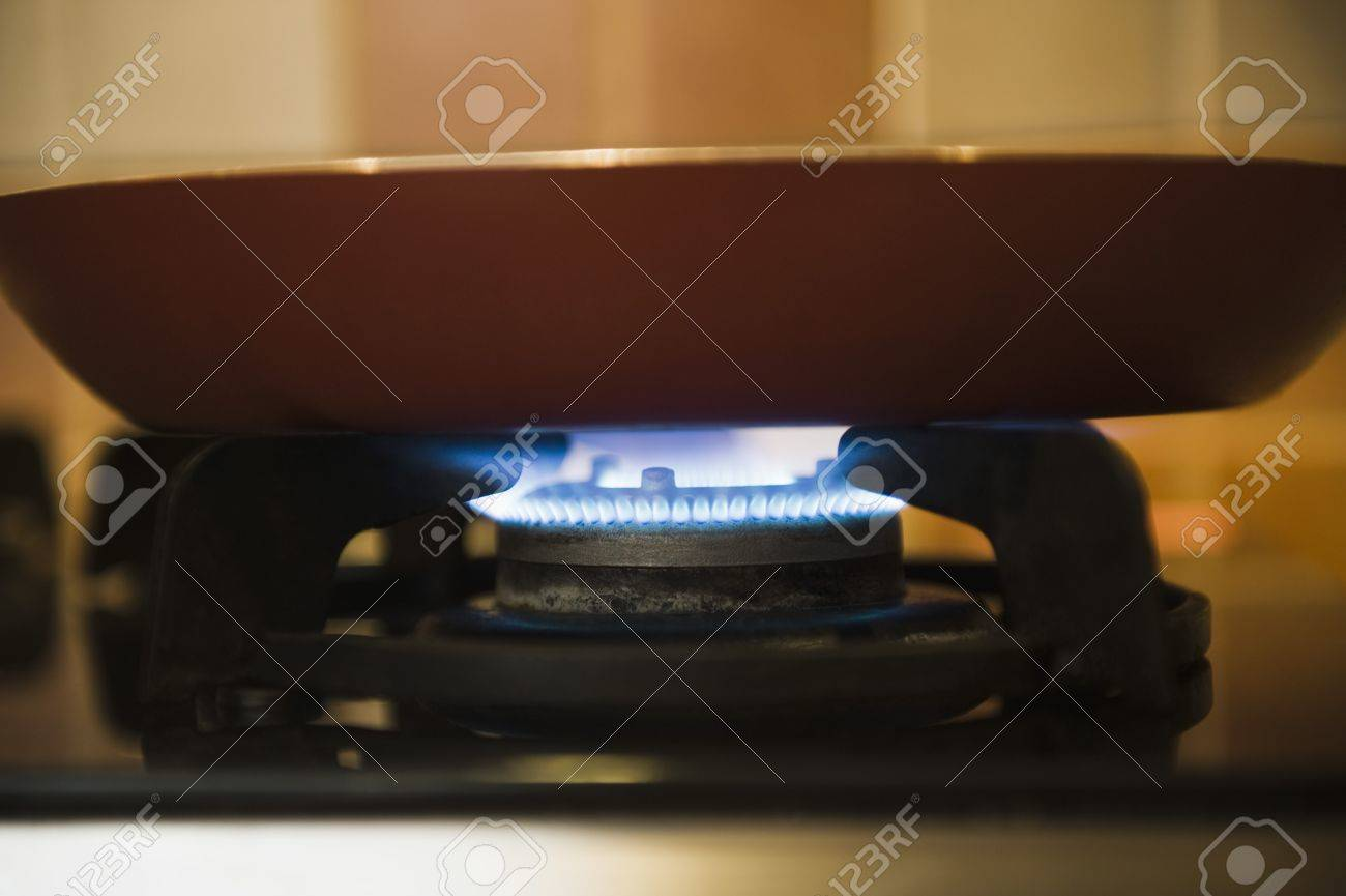Close-up of a pan on a gas stove burner Stock Photo - 10168768