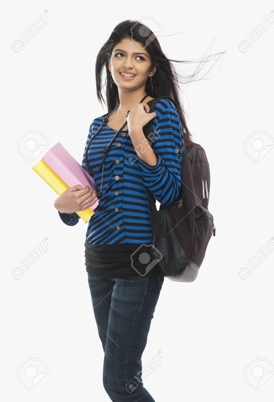 Female university student holding books and smiling Stock Photo - 10168426
