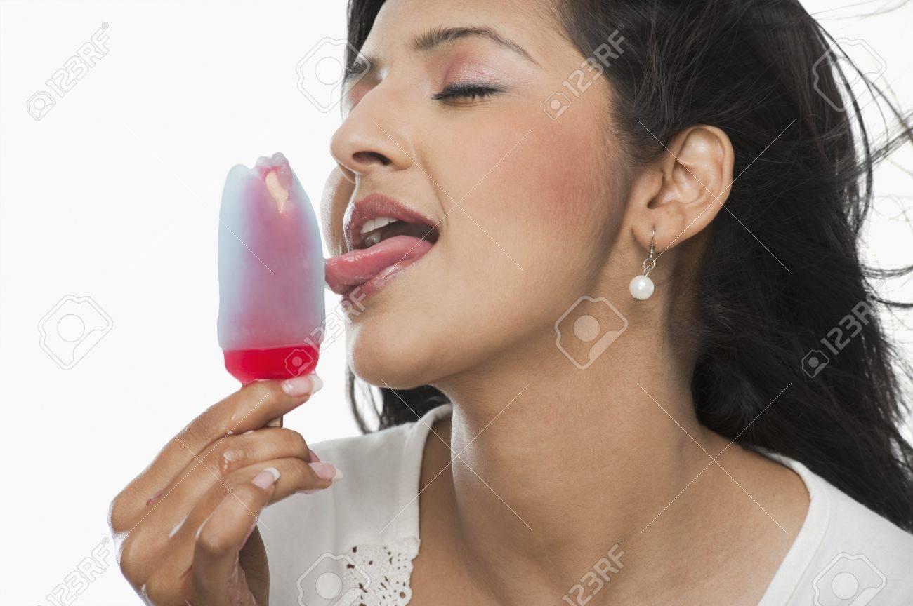 Woman lick ice cream