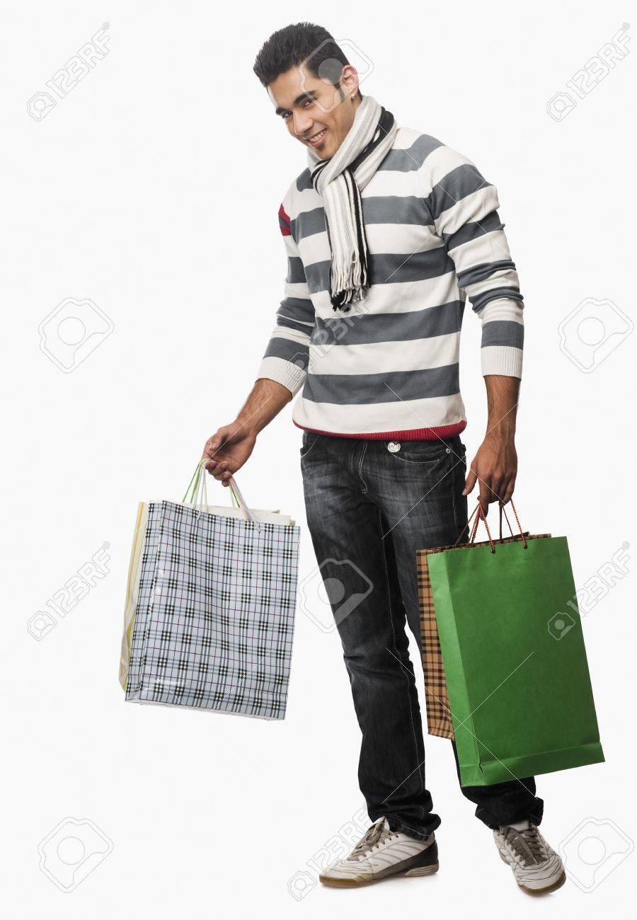 Portrait Of A Man Carrying Shopping Bags Stock Photo, Picture And ...