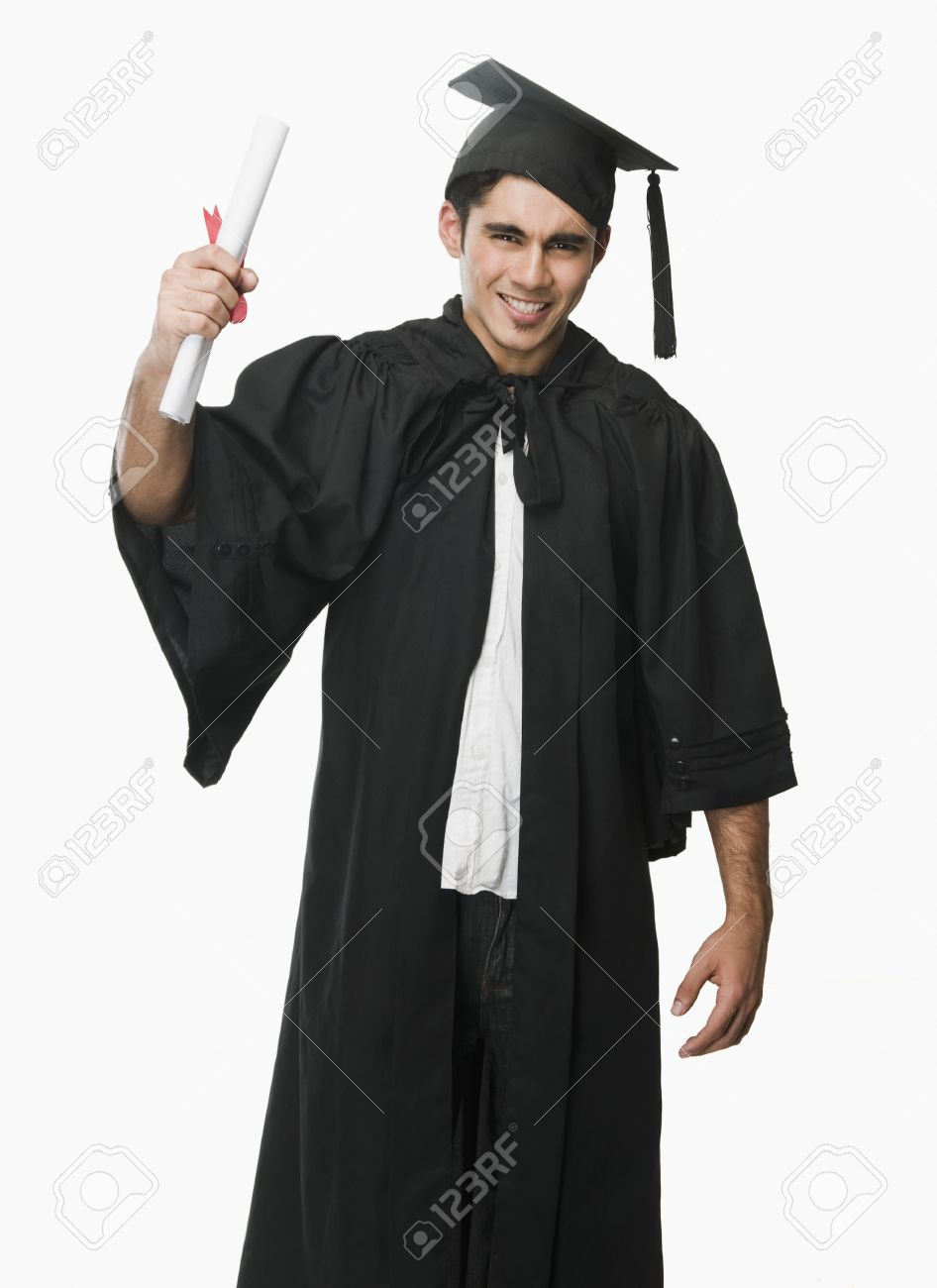 Man In A Graduation Gown Holding A Diploma Stock Photo, Picture And ...