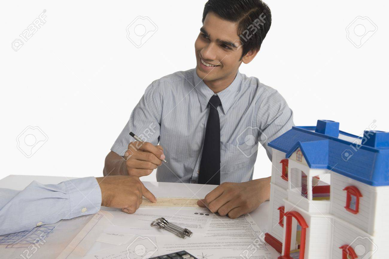 Real estate agent discussing a document with a customer Stock Photo - 10168477