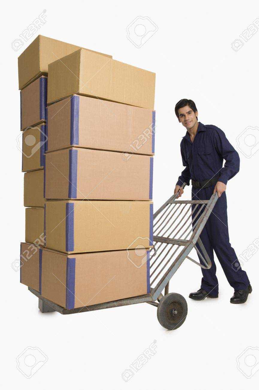 Storekeeper carrying cardboard boxes on a hand truck Stock Photo - 10167077