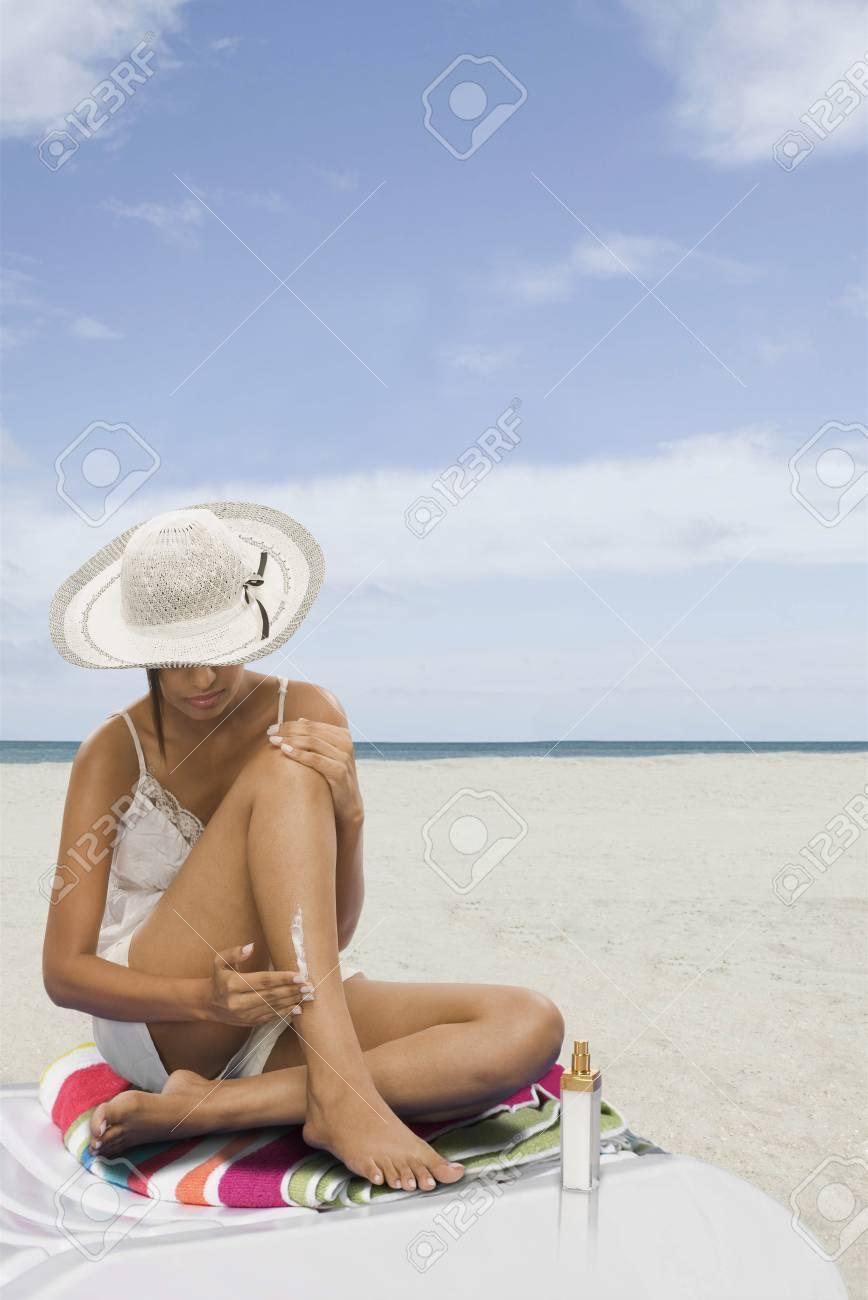 Woman applying suntan lotion on the beach Stock Photo - 10167066