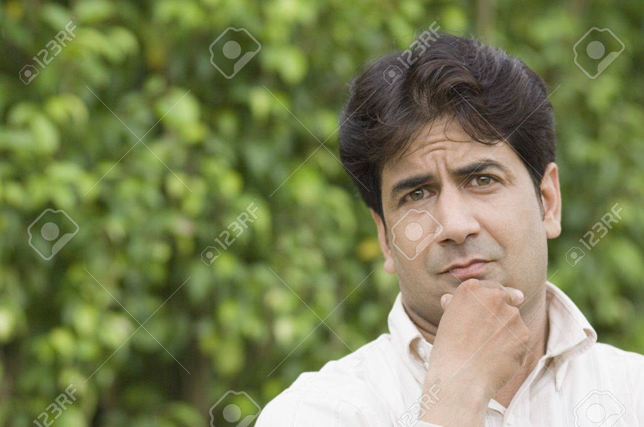 Portrait of a man thinking in a park Stock Photo - 10206717