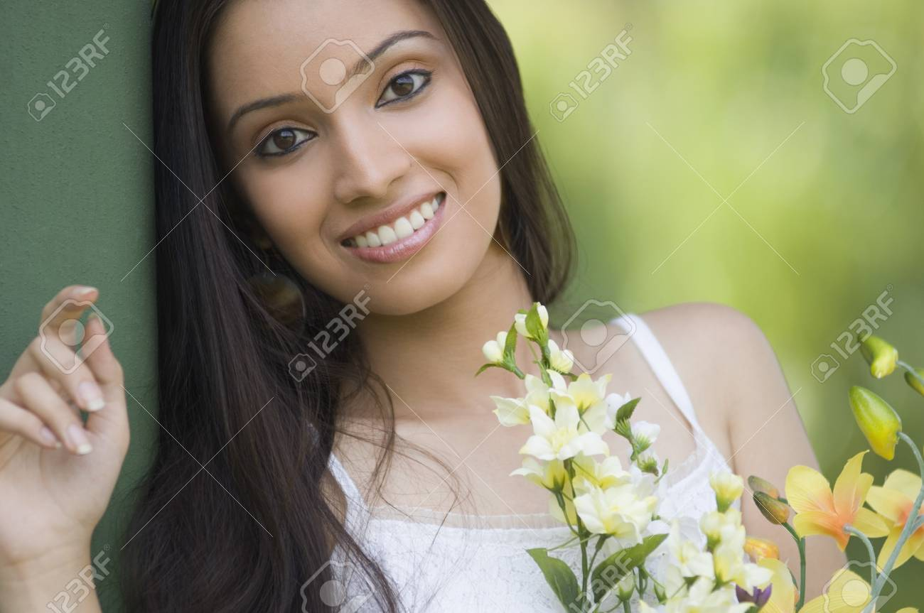 Portrait of a teenage girl with bouquet of flowers Stock Photo - 10205299