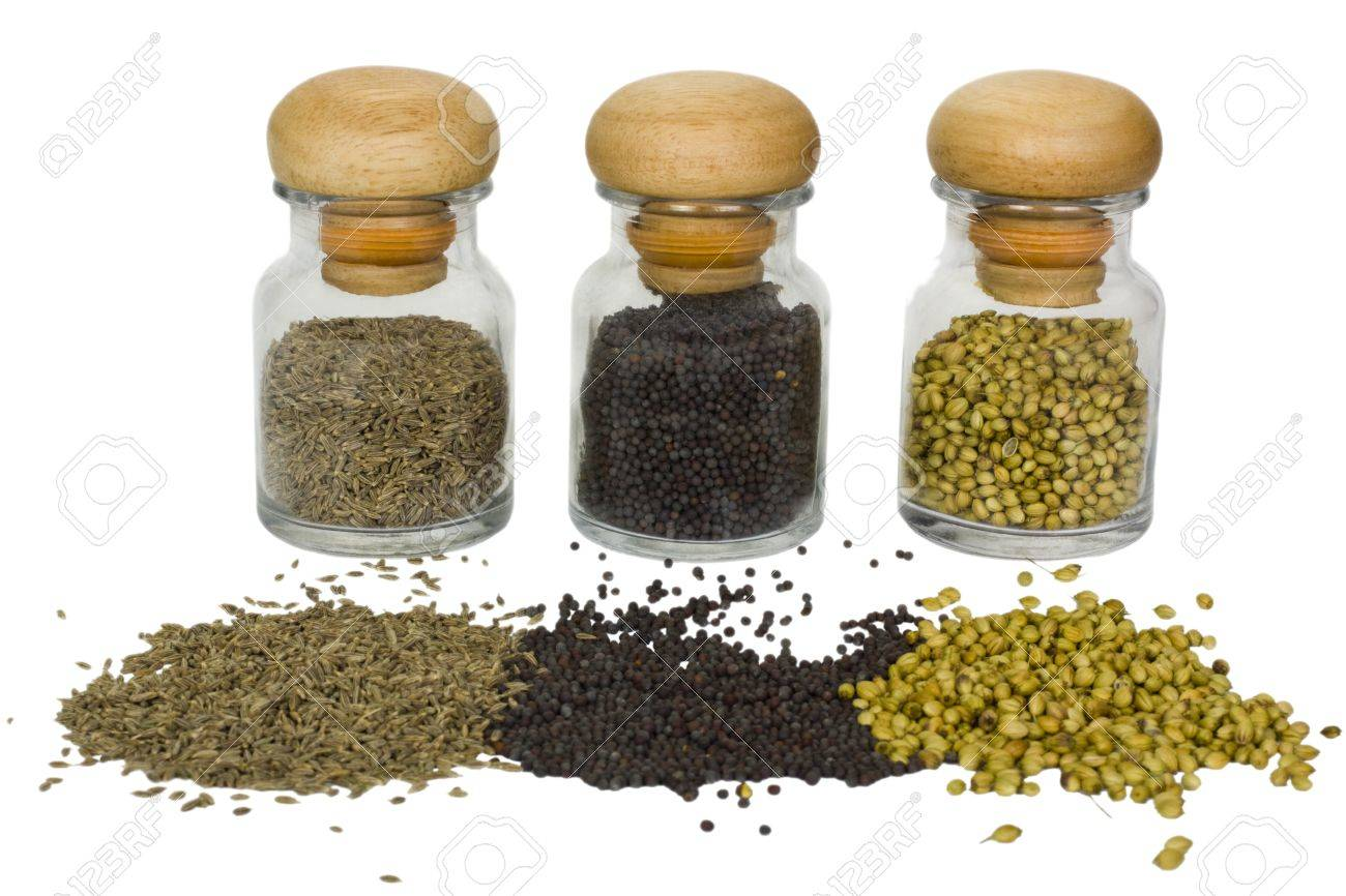 Close-up of spice containers with spilled spices Stock Photo - 10238986