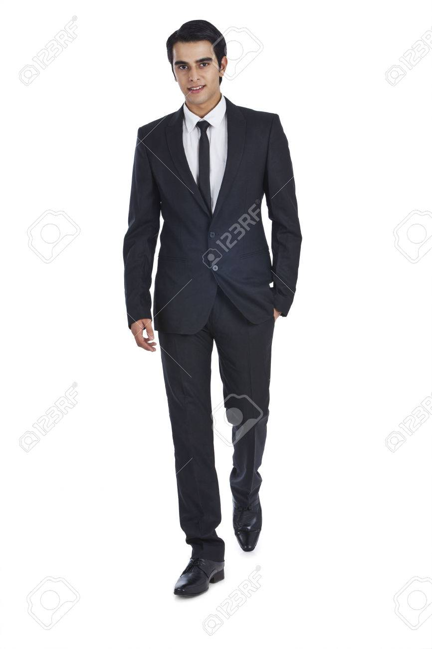 Portrait of a businessman with his hands in pockets - 24631052