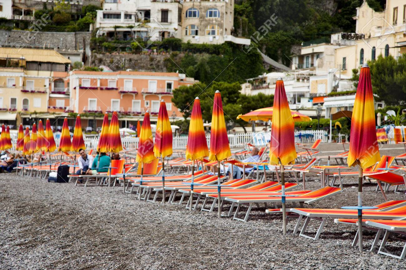 Excellent Beach Umbrellas And Lounge Chairs On The Beach Positano Amalfi Ncnpc Chair Design For Home Ncnpcorg