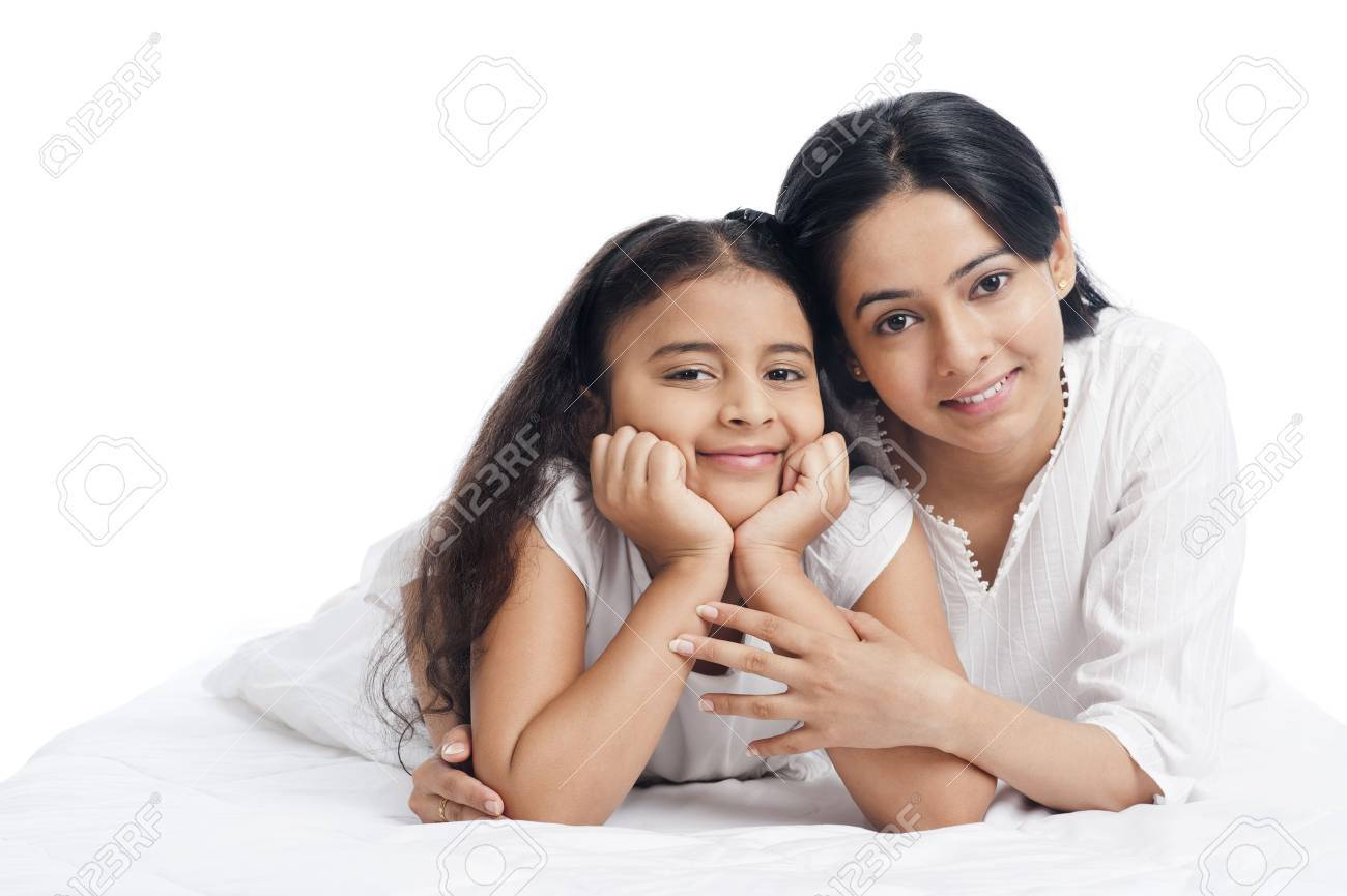 Portrait of a woman smiling with her daughter - 29440253
