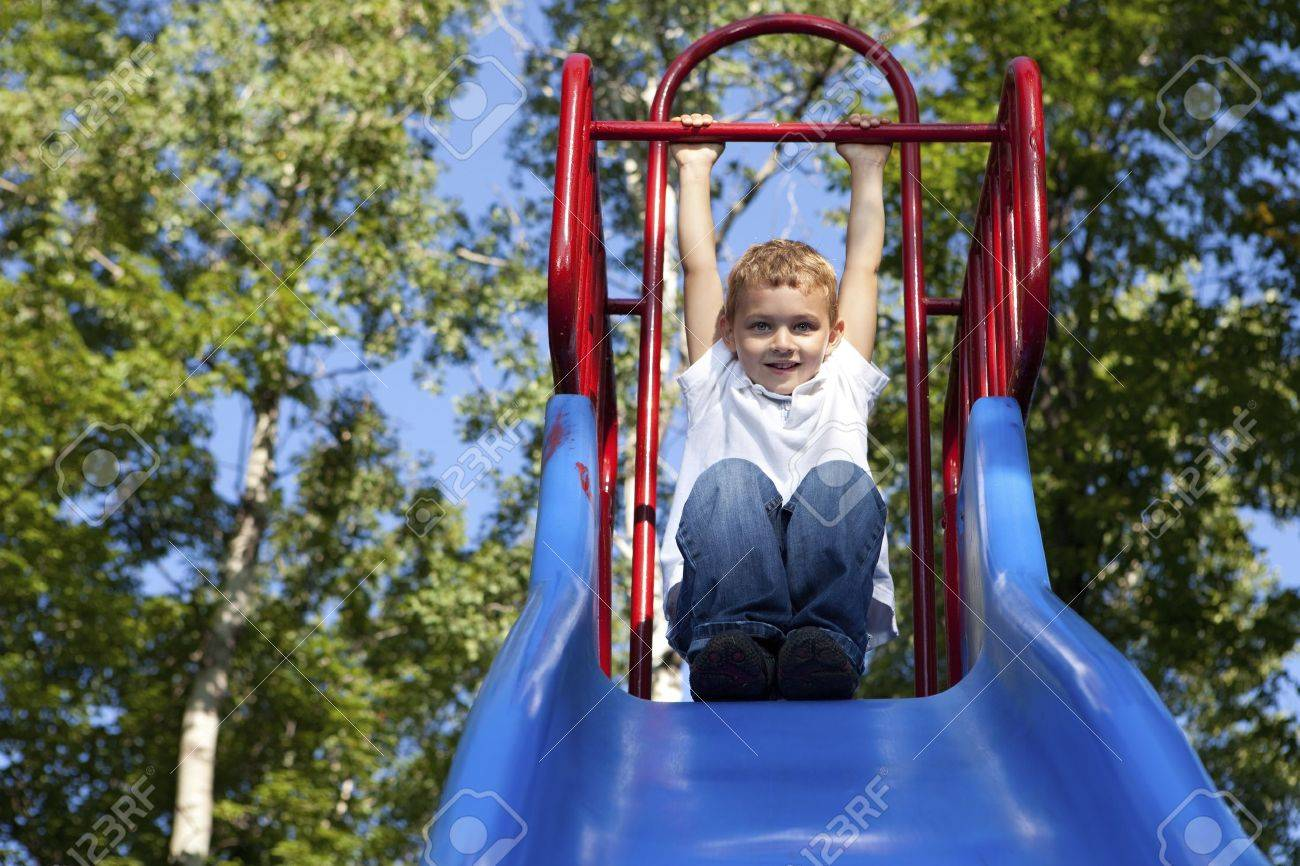 Boy Playing on a slide at the park Stock Photo - 10522553
