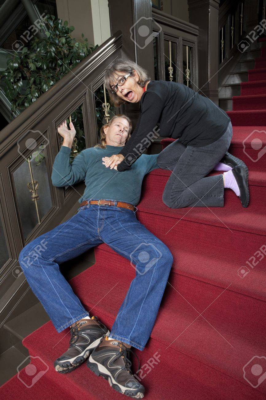 Call 911 Woman giving CPR to passed out man Stock Photo - 10612201