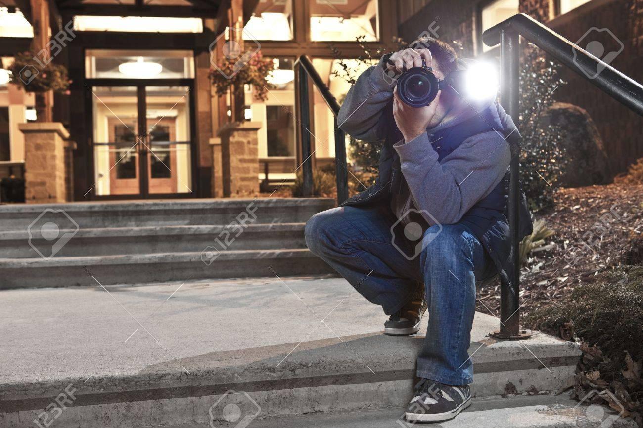Paparazzi photographer in action Stock Photo - 11552026