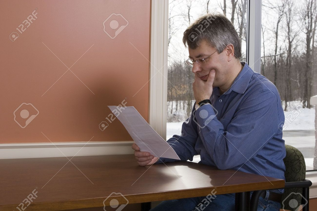 Businessman reading a letter at the library (winter) Stock Photo - 11552029