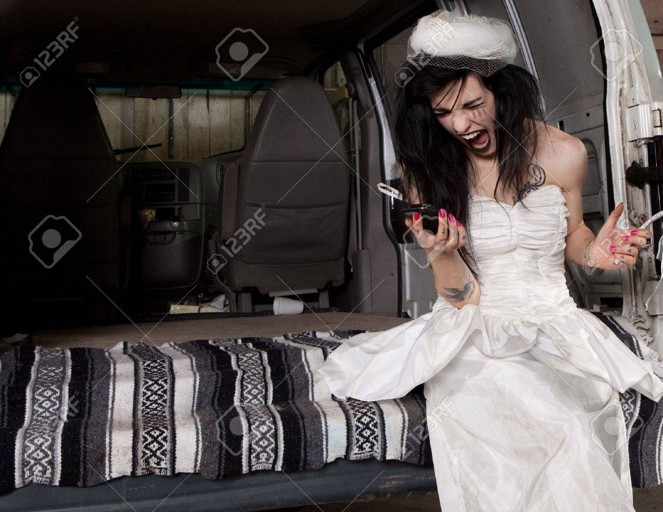 Stood up angry bride screaming at her phone Stock Photo - 11700151