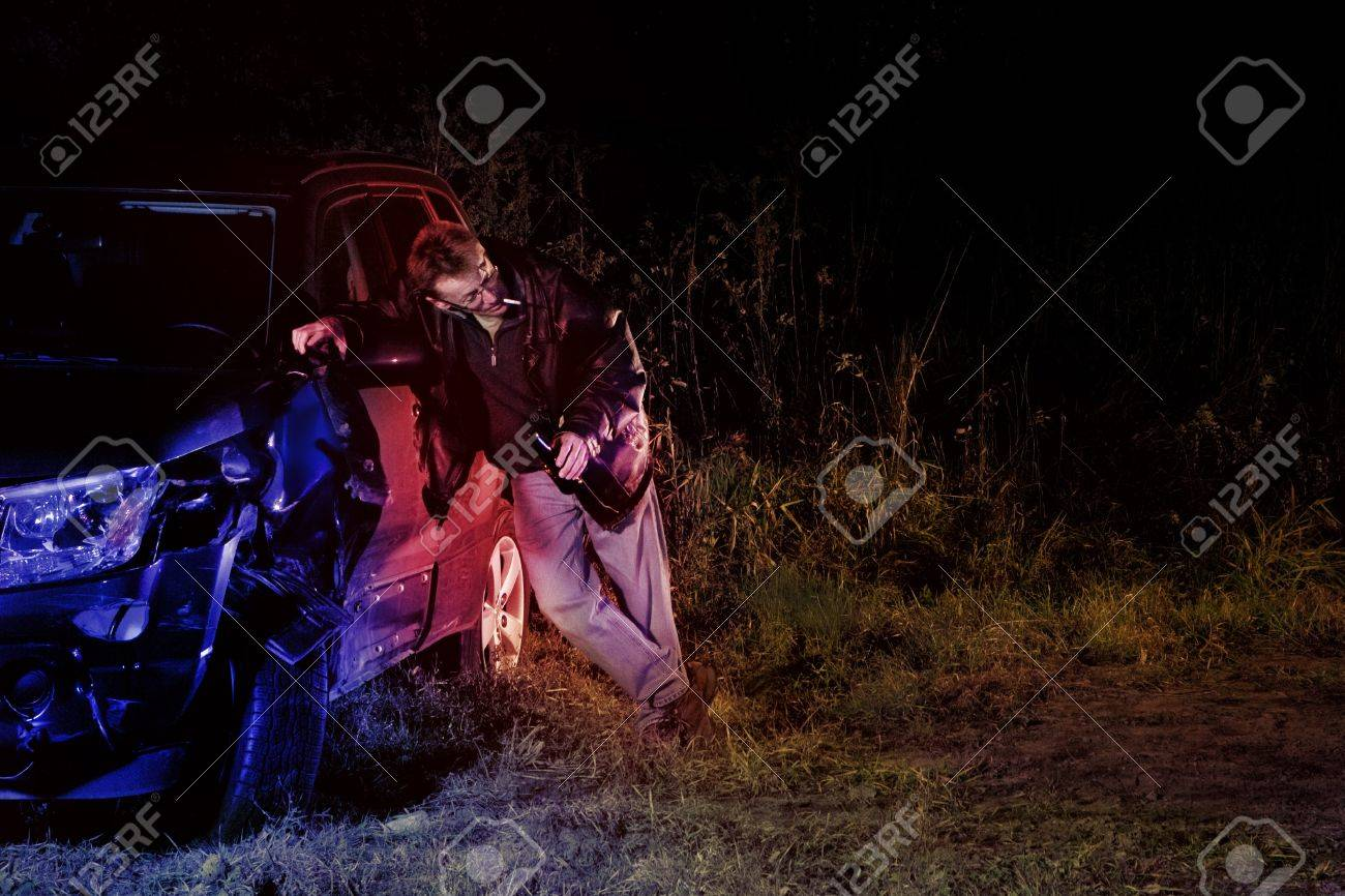 Drunk man in a car accident caught by police after a hit and run Stock Photo - 11700147