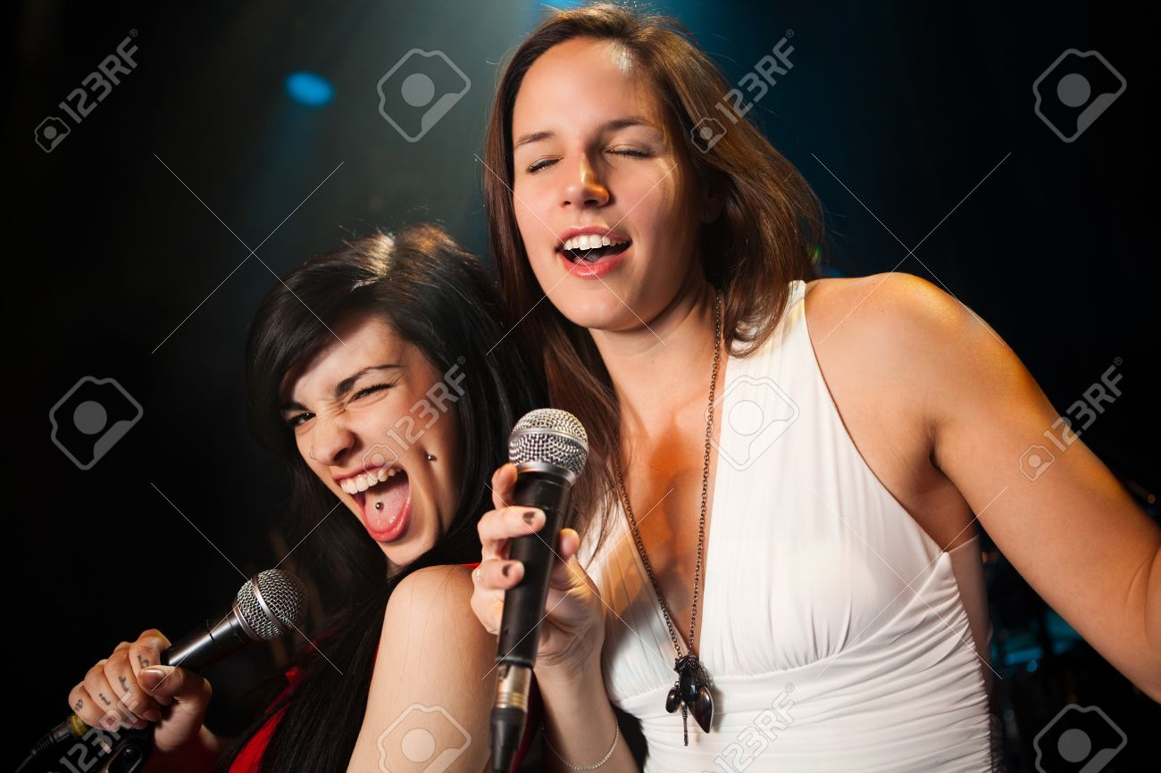 Female singers performing, soft and hard duet Stock Photo - 11700111