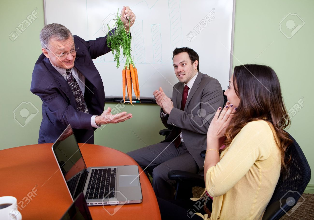The great motivator dangling carrots and Business team motivated by positive presenter, Clapping employees Stock Photo - 12065604