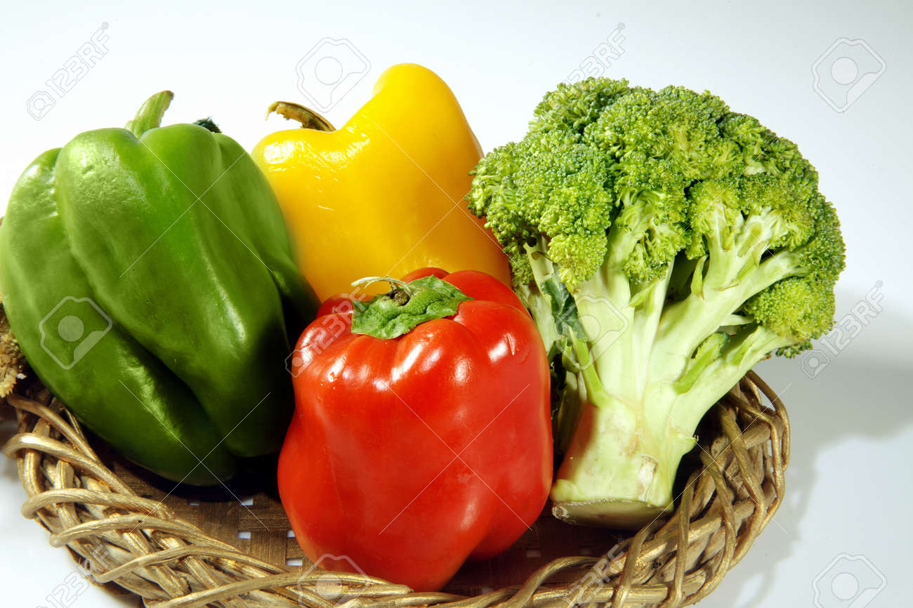 Bell peppers and broccoli in a wicker basket Stock Photo - 17327324