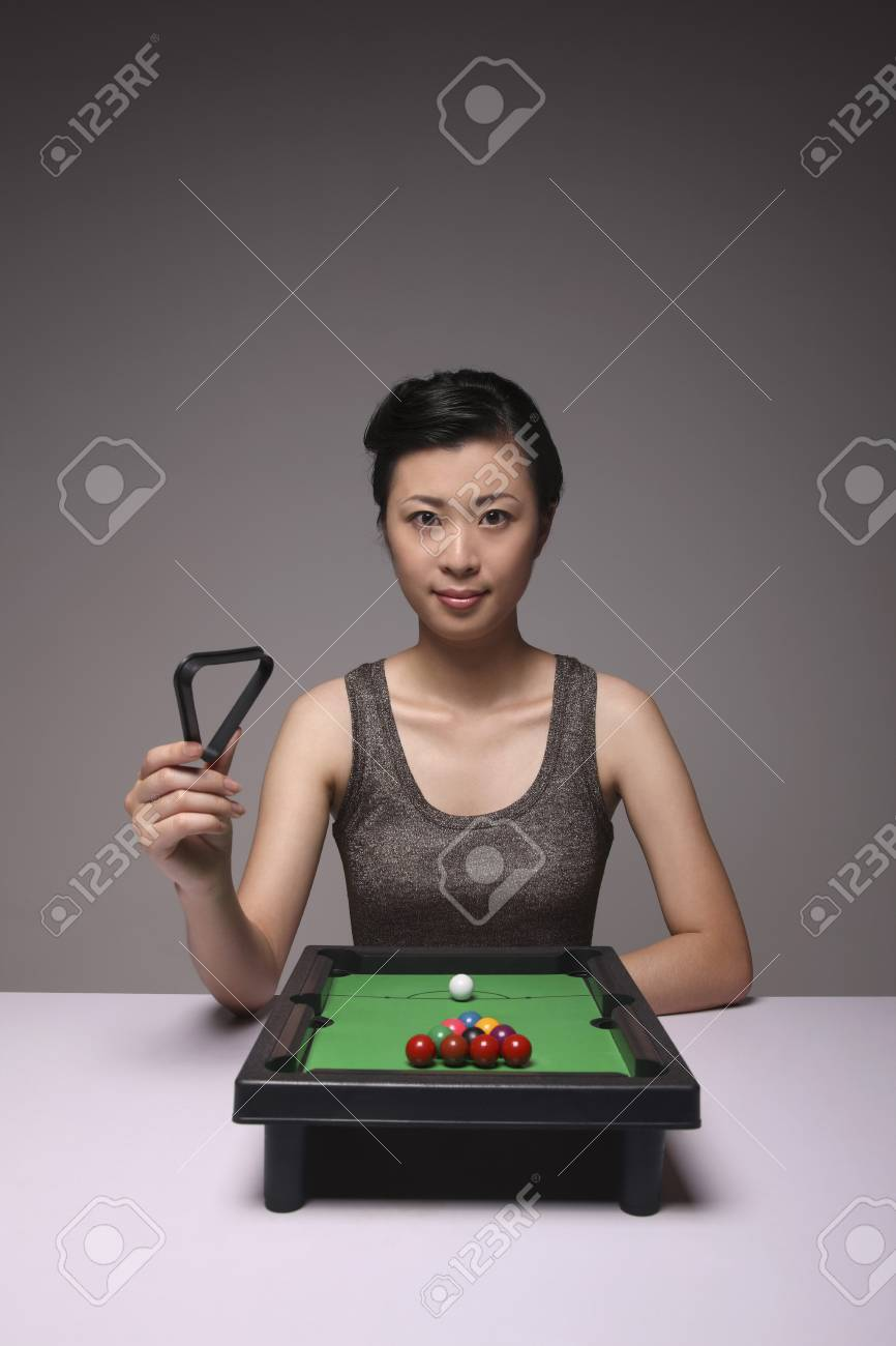 Woman Holding Miniature Rack From Toy Pool Table Stock Photo - How to rack a pool table