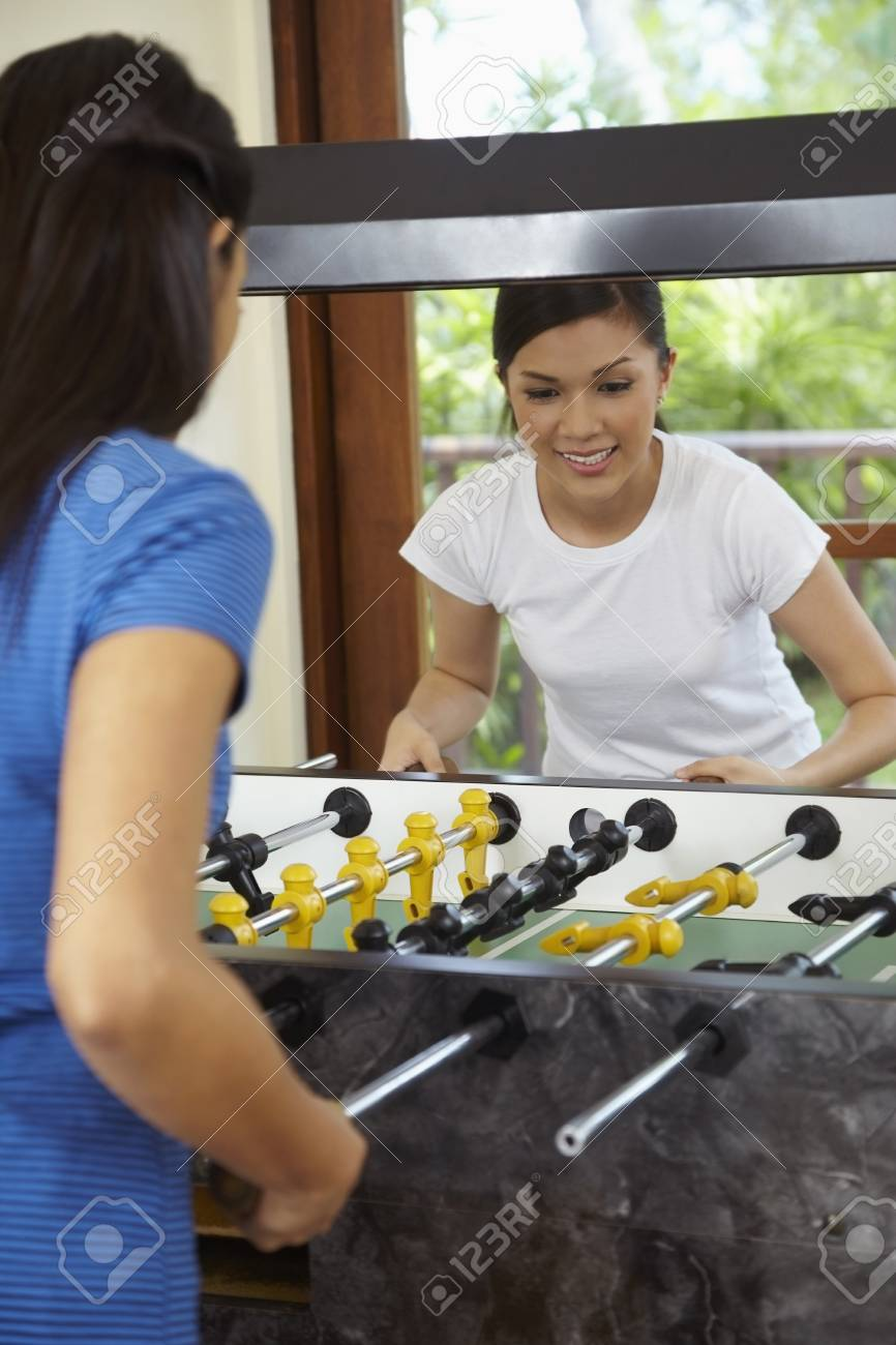 Stock Photo - Women playing table football 033c105bf2