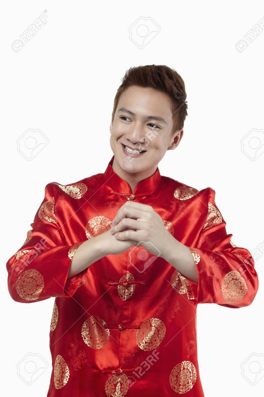 a9cecae5b Man in traditional clothing with hand clasped wishing Happy Chinese New Year  Stock Photo - 39116835