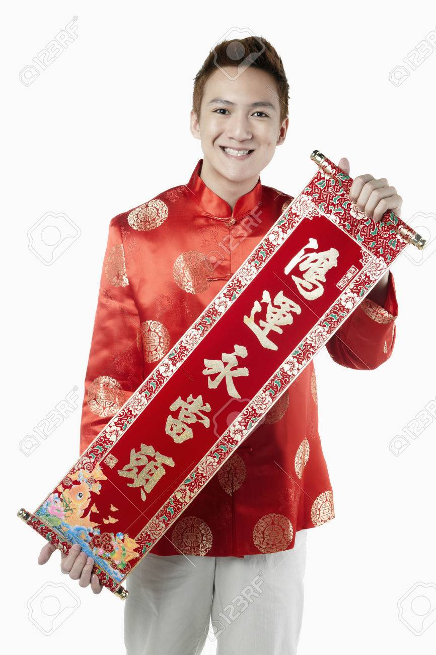 64b753261 Man in traditional clothing holding banner with Chinese New Year greetings  Stock Photo - 39116897
