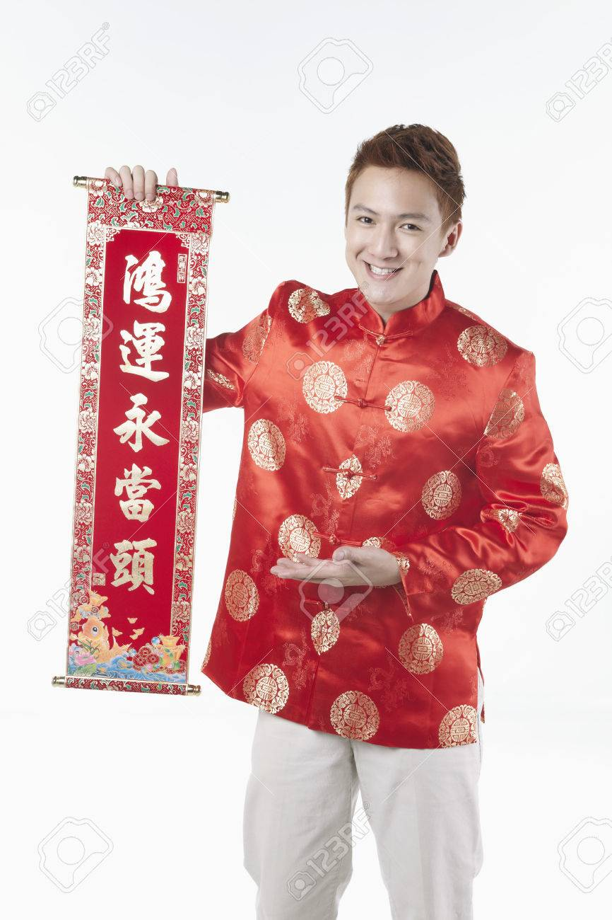 6a248c119 Man in traditional clothing holding banner with Chinese New Year greetings  Stock Photo - 39116898