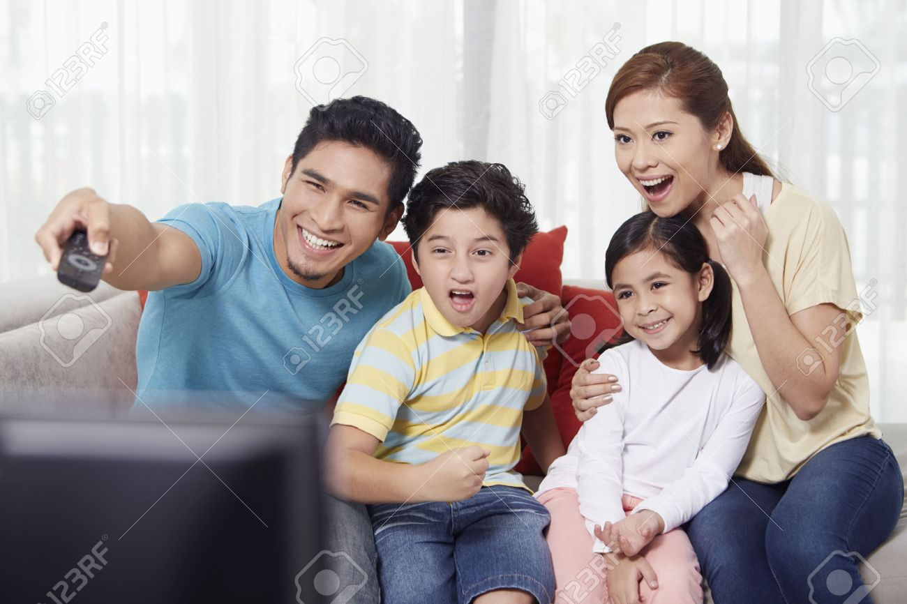 kids watching tv at night. parents and children watching television stock photo - 39117964 kids tv at night