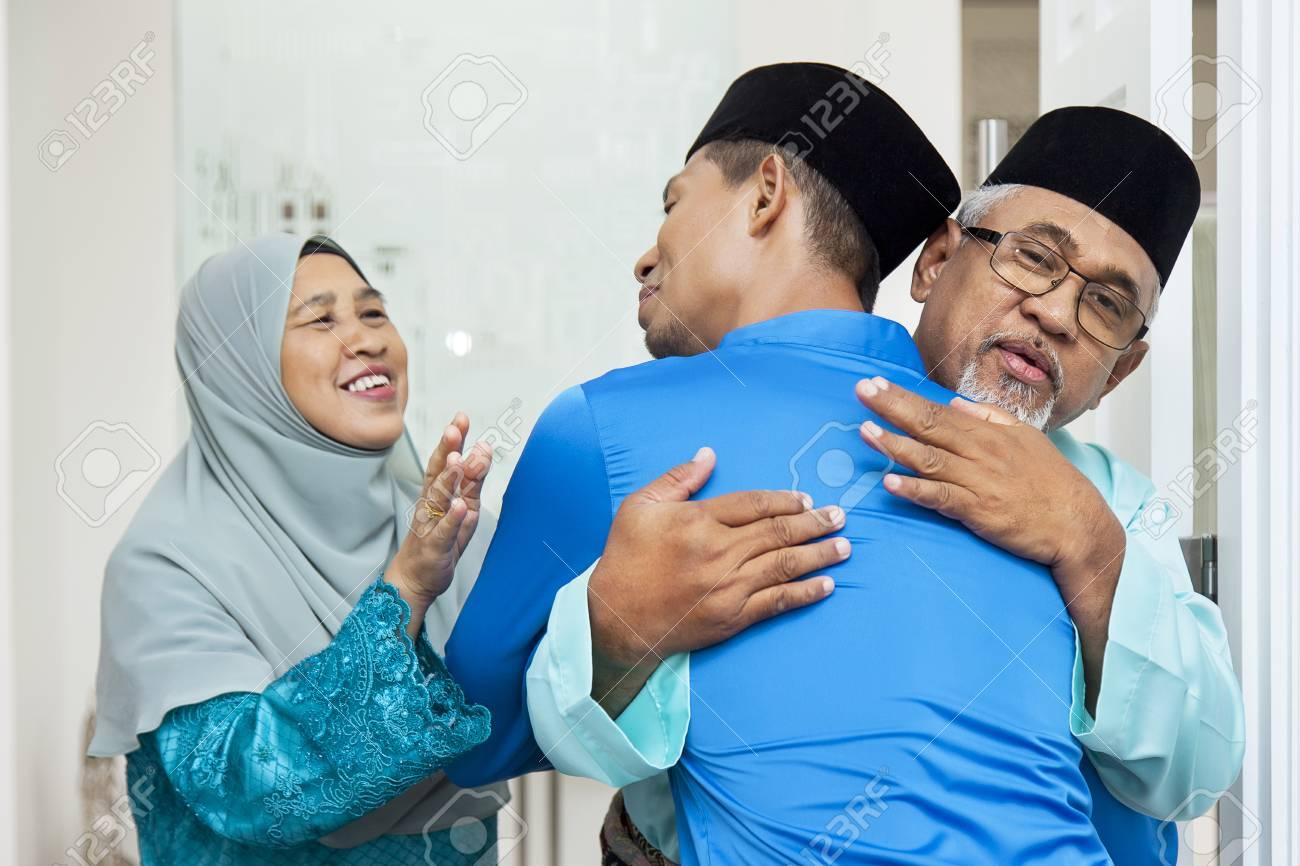 Muslim men greeting each other - 121627151