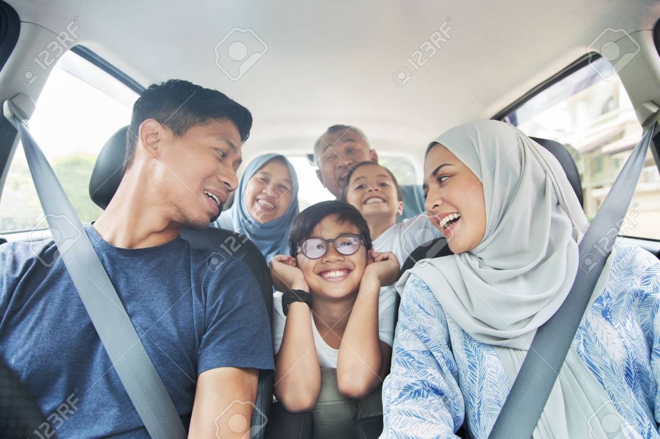 Family in a car for a trip - 123849489
