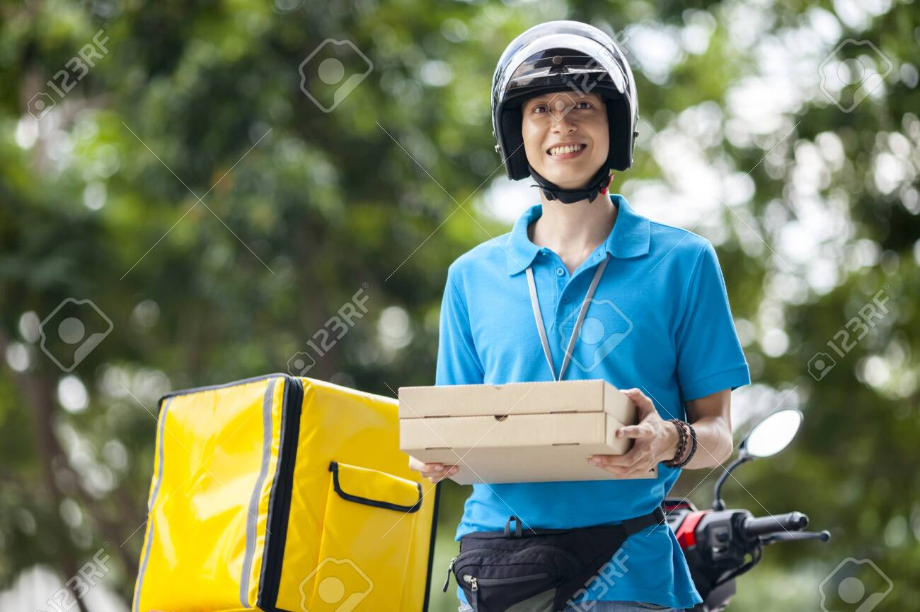 Delivery man carrying boxes of food - 126399746