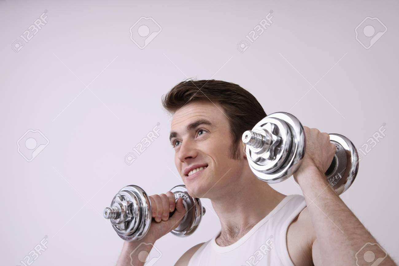 Man lifting weights Stock Photo - 6990631
