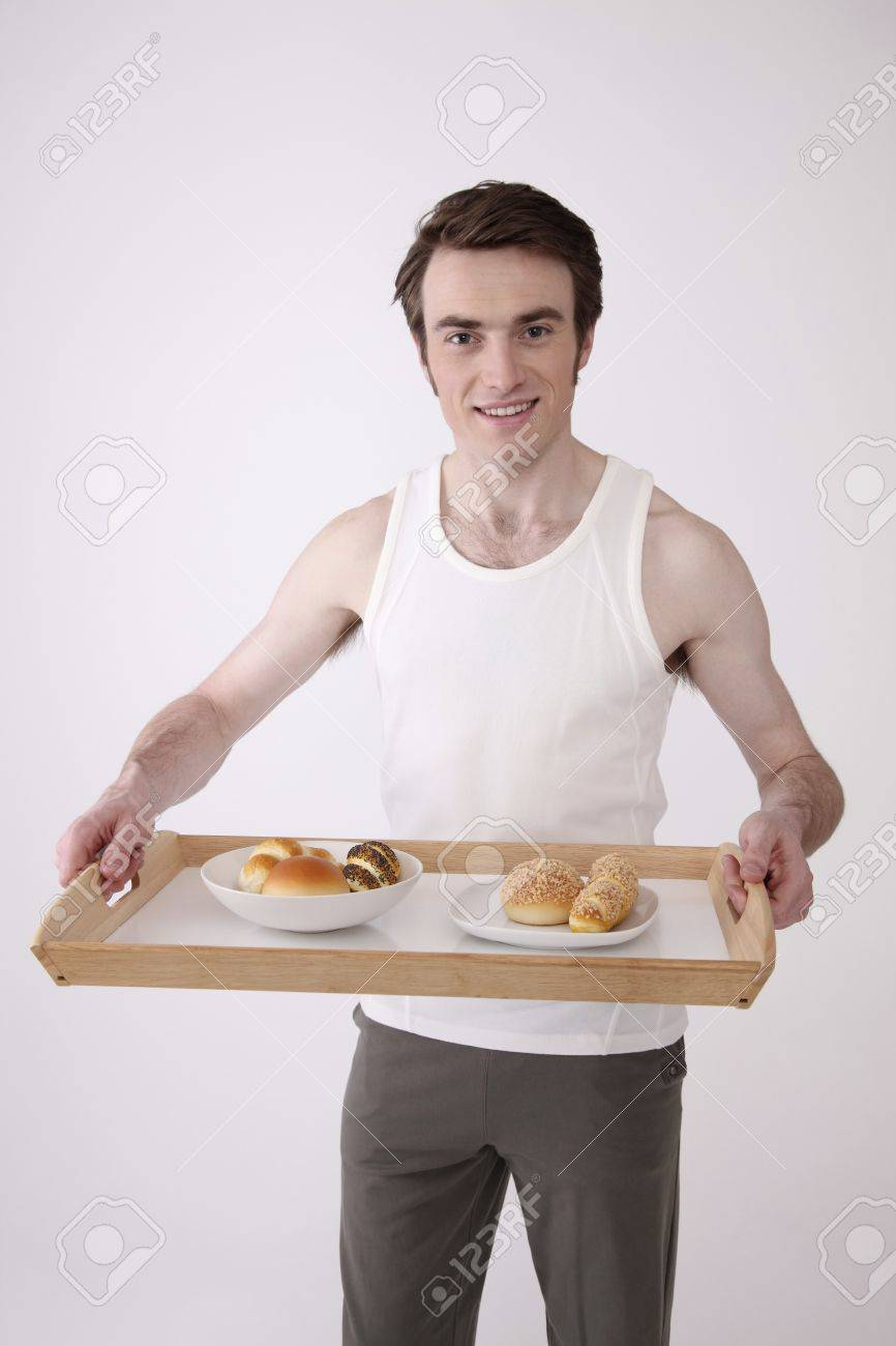 Man holding a tray with breakfast Stock Photo - 6990726