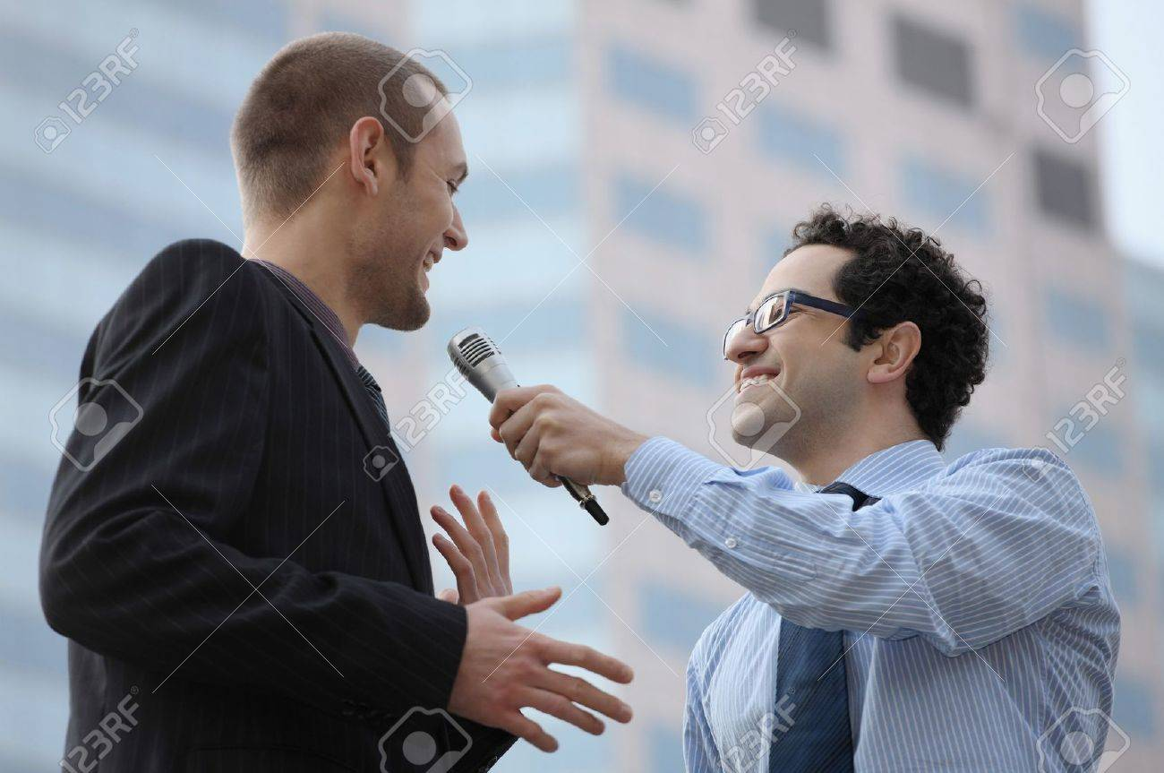Man holding microphone interviewing businessman Stock Photo - 6925067
